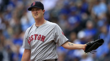 Boston Red Sox starting pitcher Steven Wright gets a new ball after giving up a two-run home run to Kansas City Royals' Eric Hosmer during the first inning of a baseball game at Kauffman Stadium in Kansas City, Mo., Wednesday, May 18, 2016. (AP Photo/Orlin Wagner)